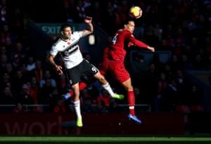 Fulham's Aleksandar Mitrovic battles Liverpool's Virgil van Dijk at Anfield. Liverpool won the match 2-0.
