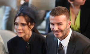 David and Victoria Beckham take their seats in St George's Chapel