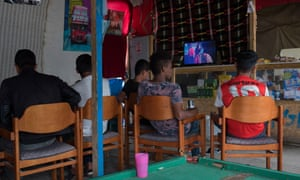 Child refugees pass the time at the Kids Cafe in the Jungle, Calaia