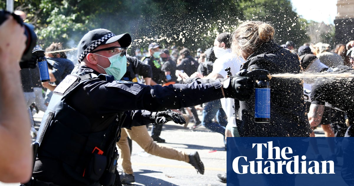 Australia anti-lockdown rallies: protesters violently clash with police in Melbourne