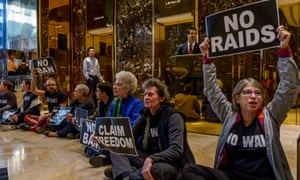 Activists unfurl anti-Trump banners inside Trump Tower to show support for refugees, immigrants, and their families in New York City earlier this month.