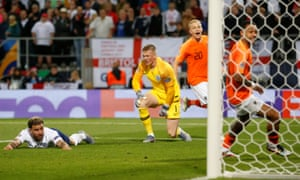 England's Kyle Walker reacts after scoring an own goal and Netherlands' second.