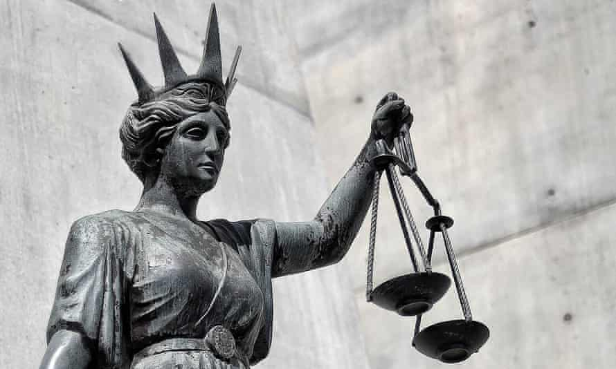 A statue of Themis, the Greek god of justice outside the supreme court in Brisbane