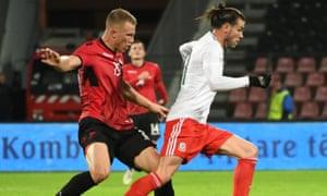 The Albania goalscorer Bekim Balaj tracks Gareth Bale during a surprise win for the home side in Elbasan.