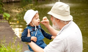 Happy momentsGrandchild and grandfather having fun outdoors.
