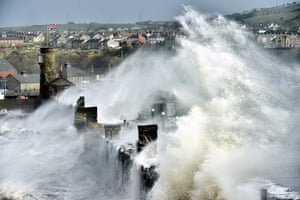 """Whitehaven harbour in Cumbria by Paul Kingston. """"Inner harbour wall at Whitehaven, Cumbria, being hit by a monstrous wave, dwarfing the surrounding manmade structures. This occurred on the day I travelled from County Durham to the west coast of Cumbria when the UK was being hit by a series of Atlantic storms sending tidal surges and strong gale force westerly winds."""""""