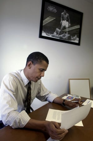 Barack Obama works in his office in 2004 beneath a photo of Muhammad Ali standing over Sonny Liston.