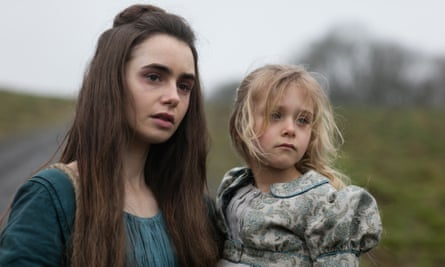 'Maman, I'm tired' … Fantine (Lily Collins) with Cosette (Mailow Defoy).