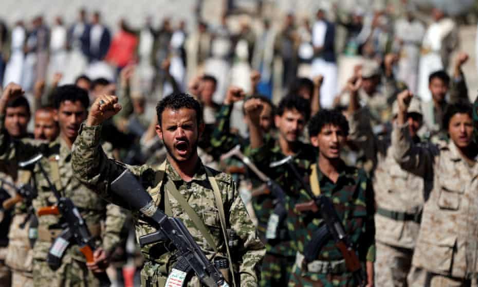 Houthi militants march in Sanaa, Yemen.