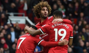 Marouane Fellaini celebrates after scoring the last minute winner for United.