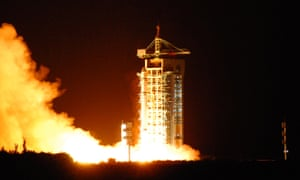 China's Micius satellite blasts off from Jiuquan in Gansu on 16 August 2016. Photons were beamed from a ground station in Ngari in Tibet to Micius satellite, which is in orbit 300 miles above Earth.