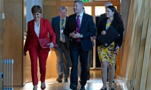 The Scottish finance secretary, Derek Mackay, centre, with the first minister Nicola Sturgeon arrive at Holyrood, Edinburgh.