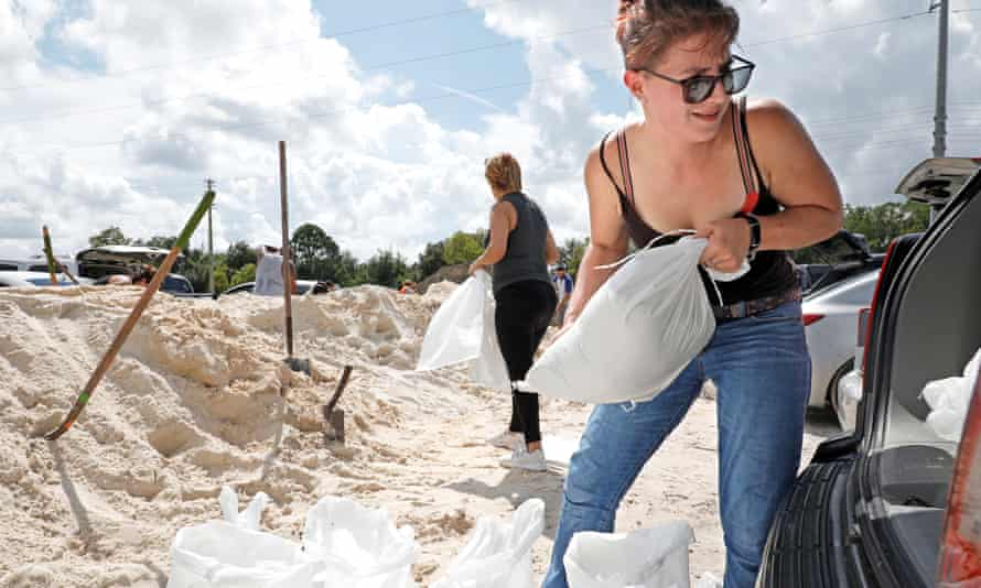 Residents fill sandbags ahead of the arrival of Hurricane Dorian in Kissimmee, Florida.