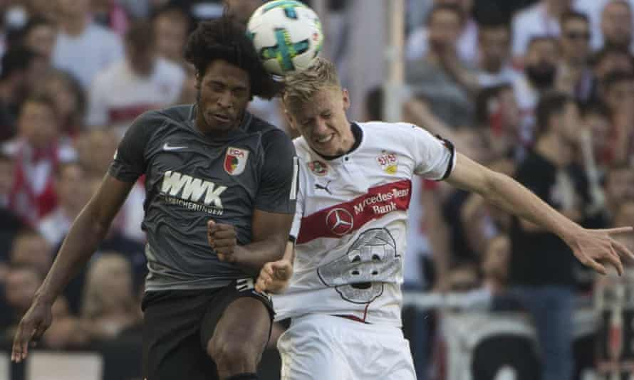 Stuttgart's Timo Baumgartl (right) leaps for a header against Augsburg, with Fritzle on his shirt.