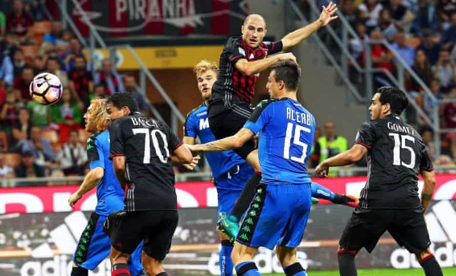 Milan defender Gabriel Paletta heads home the winner.