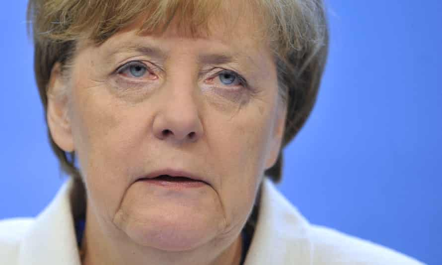 Angela Merkel holds a press conference at the end of talks over the Greek debt crisis
