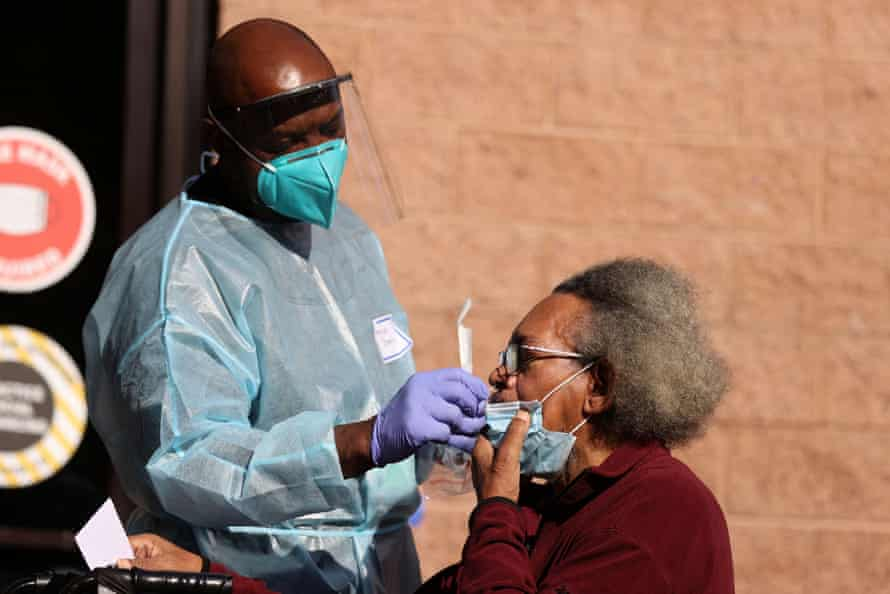 A nurse administers a coronavirus test at the Los Angeles Mission homeless shelter.