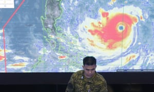 A member of the Philippine air force briefs president Duterte at the national disaster centre in Manila on Thursday.