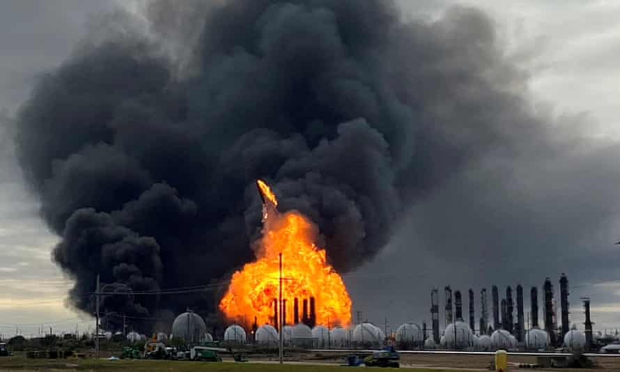 A process tower flies through the air after exploding at a TPC group plant in Port Neches, Texas, on 27 November.
