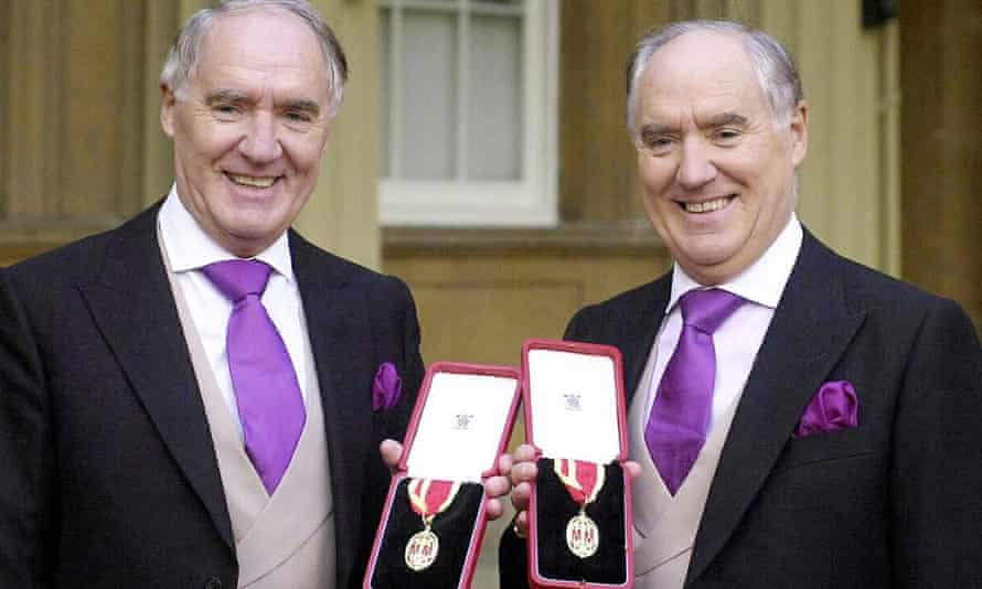 Sir David Barclay, now deceased (left) and his twin brother Sir Frederick pose after receiving their knighthoods from the Queen at Buckingham Palace in 2004.