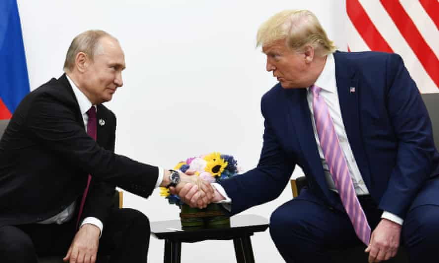 Trump with Putin in Osaka in June last year. Trump has continued his obsequious behavior towards the Russian president.
