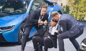 BMW staff help Harald Krüger to his feet.
