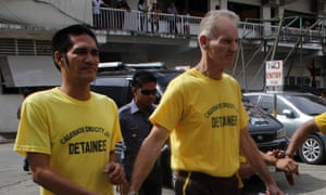 Gerard Peter Scully of Australia (R), accused of raping and trafficking two girls in the Philippines, leaves the court handcuffed to another inmate (L) after his arraignment in Cagayan de Oro City, on the southern Philippine island of Mindanao on June 16, 2015.