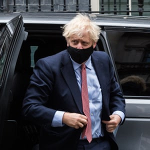 Boris Johnson arriving in Downing Street earlier after delivering his leader's speech at a Conservative Party conference, which was held online due to the coronavirus pandemic.
