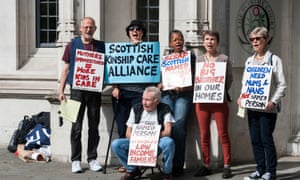 Protestors outside the supreme court in London after judges ruled against the Scottish government's named person scheme