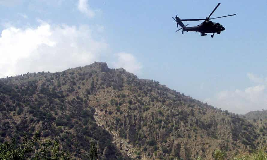 Apache helicopter  manoeuvring over Afghanistan
