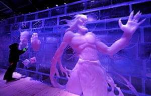 Bruges, BelgiumAn artist works at the Ice Sculpture festival.