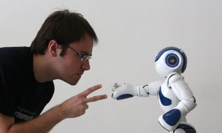 Edinburgh International Science festival<br>Student Alejadro Bordallo plays rock-scissors-paper with a robot programmed by scientists to use artificial intelligence