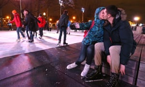 A couple take a kiss-selfie while skating in Moscow.