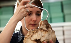A woman measures the skull of Cheddar Man in 2010.