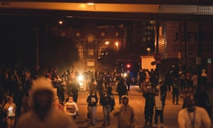 Protesters march under an overpass downtown in Louisville, Kentucky.