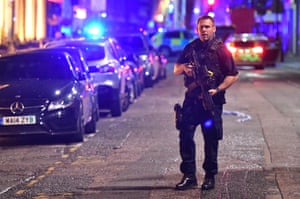 Armed police on Borough High Street as police deal with a 'major incident' at London Bridge