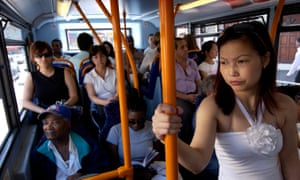 Bus passengers on the crowded lower deck of a number 30 bus
