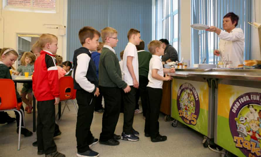 Pupils line up for breakfast at Forest Academy.
