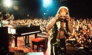 Elton John performing on stage circa 1974.