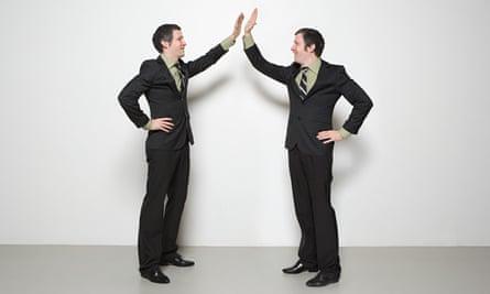 businessmen high five