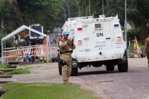 A UN peacekeeper holds his radio as he patrols after violence erupted in Kinshasa