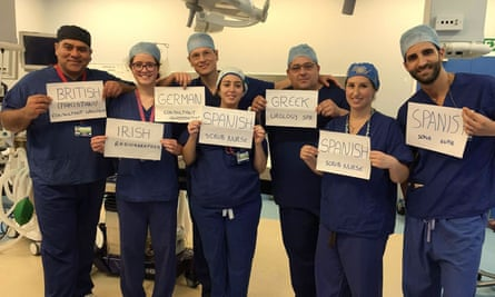 An NHS surgical team who come from around the European Union in a photograph that has been shared widely online this week.