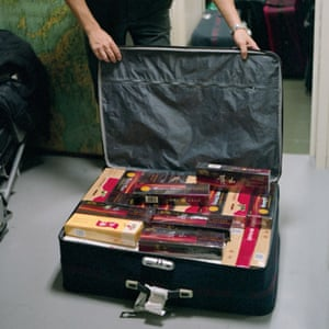 Fiumicino, Italy An officer of the Guardia di Finanza, Italy's 'financial police,' showing the contents of a suitcase seized at the airport containing 6,000EUR worth of cigarettes intended for the Italian-Chinese community.