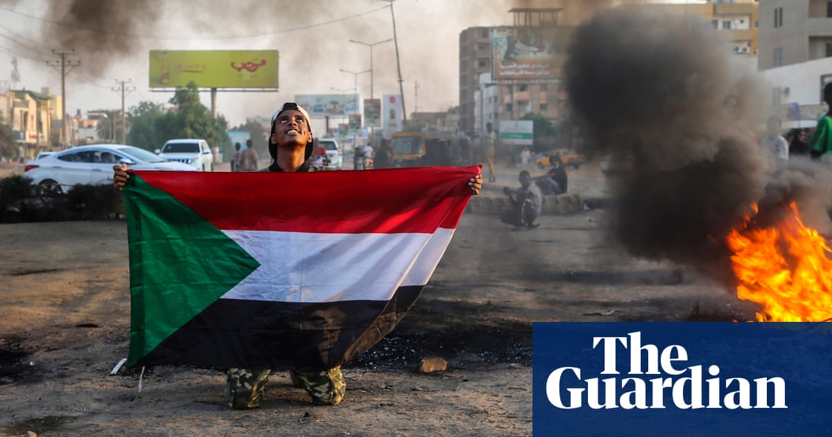 Sudan coup: deposed PM allowed home as general says politicians 'stirred up strife'