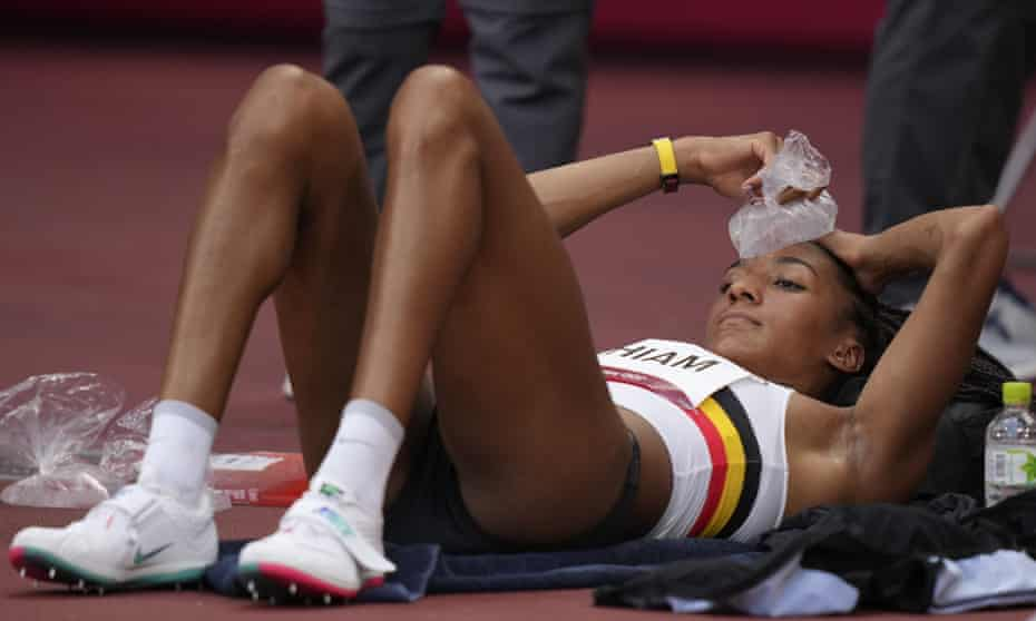 Heptathlon gold medalist Nafissatou Thiam cools down with an ice pack during sweltering heat in Tokyo