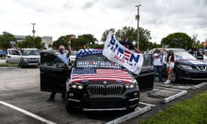 Supporters of the Joe Biden-Kamala Harris presidential ticket await Barack Obama's rally for the Democrats in Florida this afternoon.