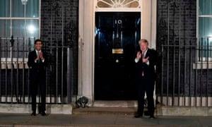 Sunak and Johnson clapping