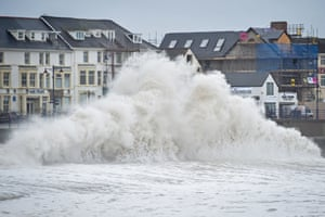 Huge waves hit the sea wall in Porthcawl, Wales, as gales of up to 80mph from Storm Brendan caused disruption around the UK