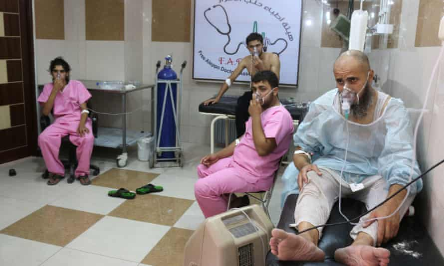 Syrians suffering from breathing difficulties are treated at a makeshift hospital in Aleppo after regime helicopters dropped barrel bombs on the rebel-held Sukkari neighborhood on Tuesday.
