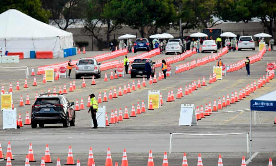 People arrive in their vehicles to receive Covid-19 vaccines at the Fairplex in Pomona, California.